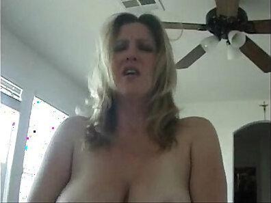 Busty cougar wife sucks his cock