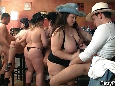 Brunette in a group fuck orgy