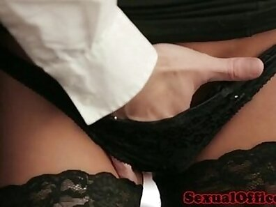 Busty secretary stocking up for office