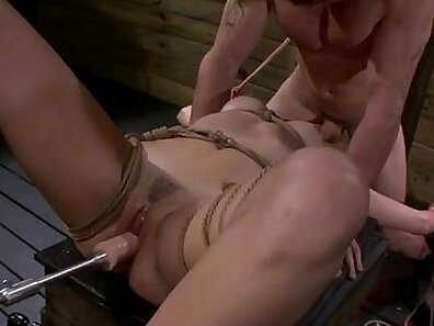 BDSM babe fucked by a cock machine