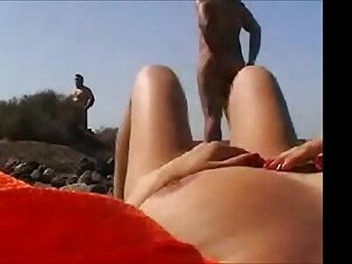 Dirty wife with massive boobs pinari masturbating on busy Thai beach